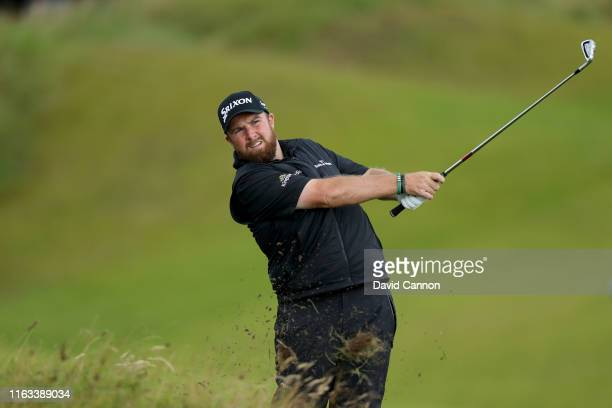 Shane Lowry of Ireland plays his second shot on the eighth hole during the final round of the 148th Open Championship held on the Dunluce Links at...
