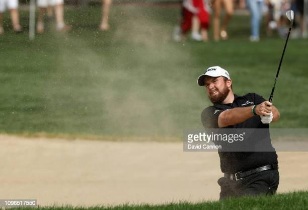 Shane Lowry of Ireland plays his second shot on the par 4 first hole during the final round of the Abu Dhabi HSBC Golf Championship at the Abu Dhabi...