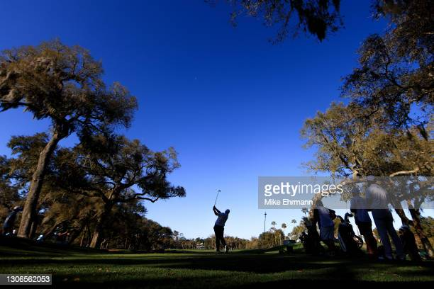 Shane Lowry of Ireland plays his shot from the 12th tee during the first round of THE PLAYERS Championship on THE PLAYERS Stadium Course at TPC...