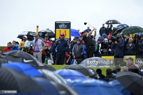 Shane Lowry of Ireland plays his shot from the 14th tee during the second round of the 148th Open Championship held on the Dunluce Links at Royal...