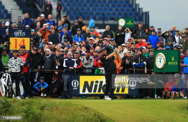 Shane Lowry of Ireland plays his shot from the 14th tee during the final round of the 148th Open Championship held on the Dunluce Links at Royal...