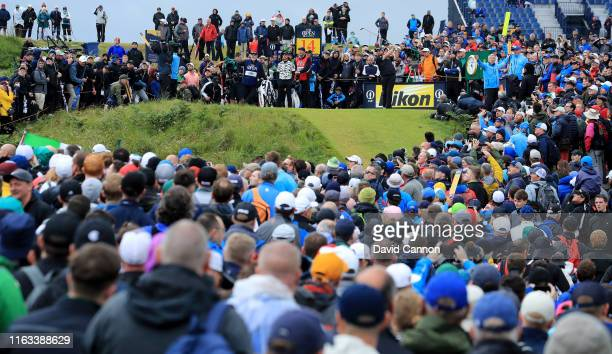 Shane Lowry of Ireland plays his tee shot on the 14th hole during the final round of the 148th Open Championship held on the Dunluce Links at Royal...