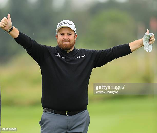 Shane Lowry of Ireland plays to the cameras after a fine second shot on the 18th hole during the Pro Am prior to the start of Made In Denmark at...