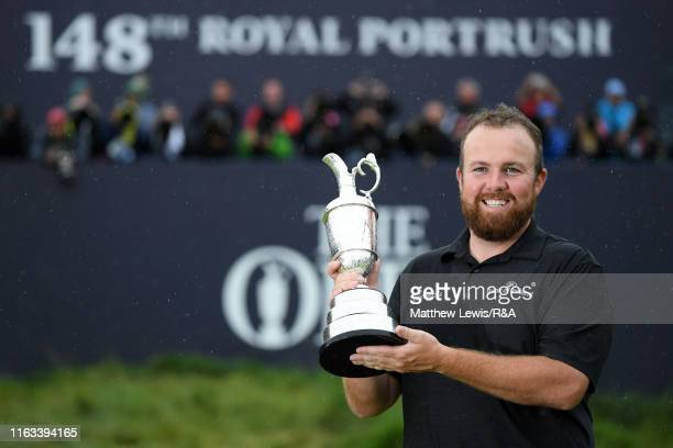 Shane Lowry of Ireland pose for a photo with the Claret Jug following his victory in the final round of the 148th Open Championship held on the...
