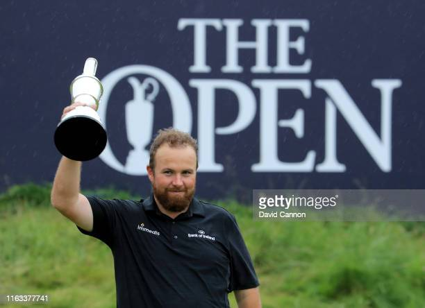 Shane Lowry of Ireland poses with the Claret Jug after his victory during the final round of the 148th Open Championship held on the Dunluce Links at...