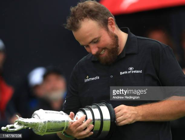 Shane Lowry of Ireland poses with the claret jug open trophy after winning the 148th Open Championship held on the Dunluce Links at Royal Portrush...
