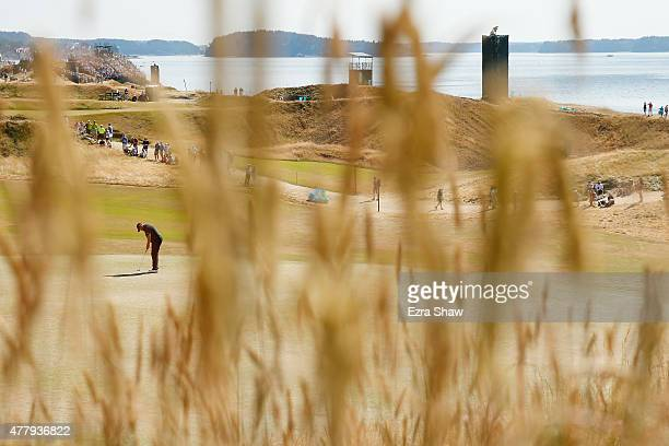 Shane Lowry of Ireland putts on the 11th green during the third round of the 115th US Open Championship at Chambers Bay on June 20 2015 in University...