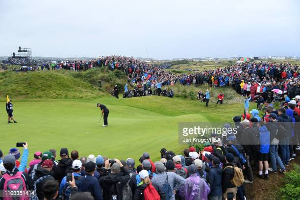 Shane Lowry of Ireland putts on the fourth hole during the final round of the 148th Open Championship held on the Dunluce Links at Royal Portrush...