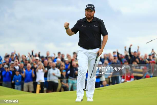 Shane Lowry of Ireland reacts to a putt on the 15th green during the third round of the 148th Open Championship held on the Dunluce Links at Royal...