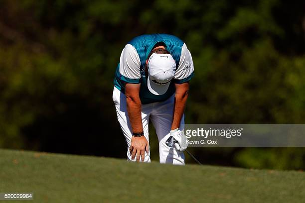Shane Lowry of Ireland reacts to a shot on the 12th hole during the third round of the 2016 Masters Tournament at Augusta National Golf Club on April...