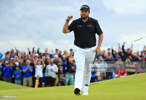 Shane Lowry of Ireland reacts to his birdie on the 15th green during the third round of the 148th Open Championship held on the Dunluce Links at...