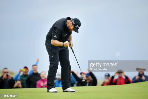 Shane Lowry of Ireland reacts to his birdie on the 15th green during the final round of the 148th Open Championship held on the Dunluce Links at...