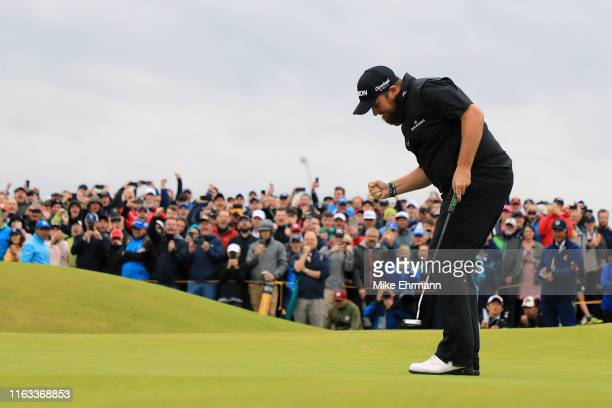 Shane Lowry of Ireland reacts to his birdie putt on the 15th green during the final round of the 148th Open Championship held on the Dunluce Links at...