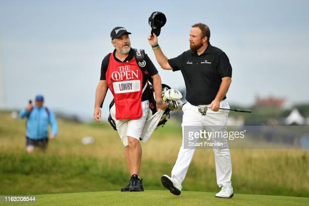 Shane Lowry of Ireland reacts to his putt on the 18th green during the third round of the 148th Open Championship held on the Dunluce Links at Royal...