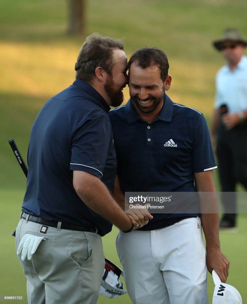 Shane Lowry (L) of Ireland shakes hands with Sergio Garcia of Spain after they halved their match during round one of the World Golf Championships-Dell Technologies Match Play at the Austin Country Club on March 22, 2017 in Austin, Texas.