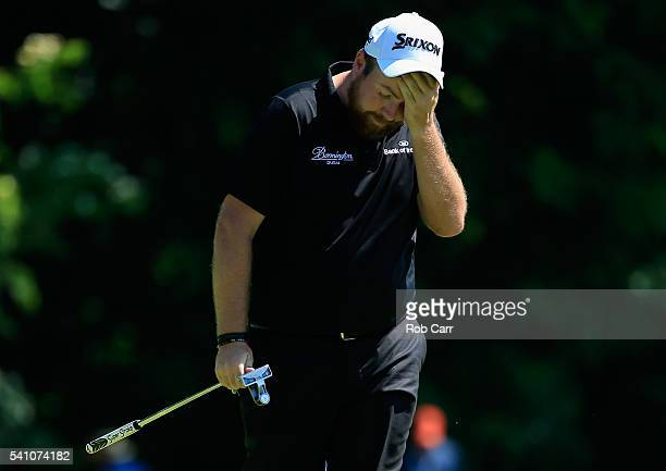 Shane Lowry of Ireland walks off the 16th green during the continuation of the second round of the US Open at Oakmont Country Club on June 18 2016 in...