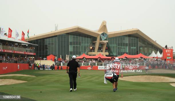 """Shane Lowry of Ireland walks up the 18th fairway with his caddie Brian """"Bo"""" Martin during day four of the Abu Dhabi HSBC Golf Championship at the Abu..."""