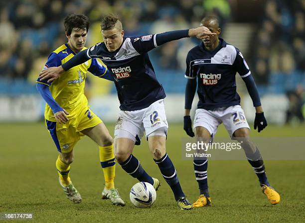 Shane Lowry of Millwall is tackled by Kieran Lee of Sheffield Wednesday during the npower Championship match between Millwall and Sheffield Wednesday...
