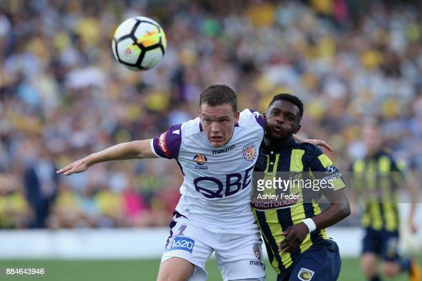 Shane Lowry of Perth Glory contests the ball against Kwabena Appiah of the Mariners during the round nine ALeague match between the Central Coast...