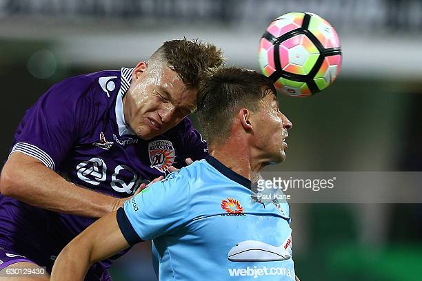 Shane Lowry of the Glory and Filip Holosko of Sydney contest a header during the round 11 ALeague match between Perth Glory and Sydney FC at nib...