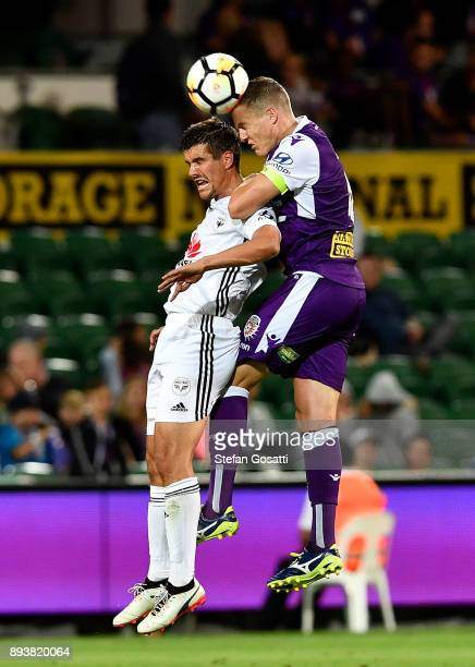 Shane Lowry of the Glory contests a header ball against Andrija Kaludjerovic of the Phoenix during the round 11 ALeague match between the Perth Glory...