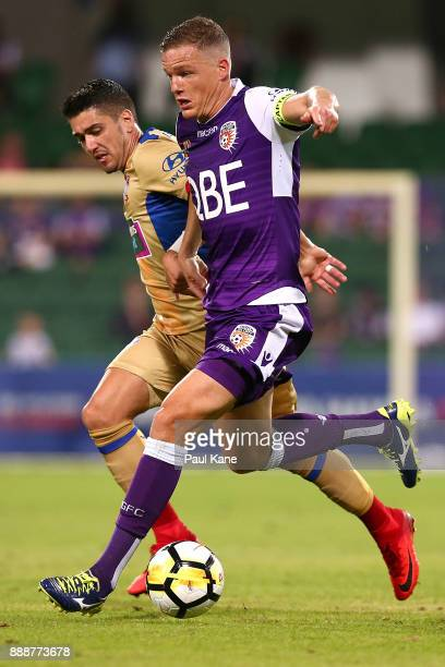 Shane Lowry of the Glory controls the ball against Dimitri Petratos of the Jets during the round 10 ALeague match between the Perth Glory and the...