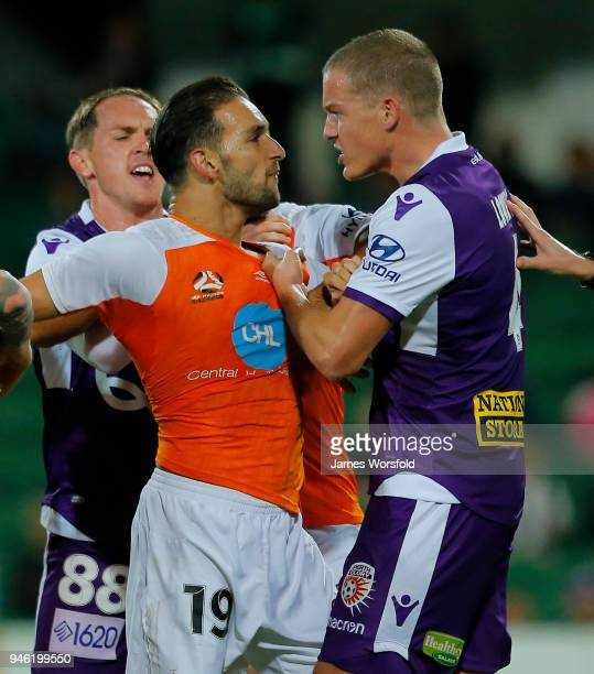 Shane Lowry of the Perth Glory and Jack Hingert of the Brisbane Roar grab jumpers during a players scuffle during the round 27 ALeague match between...