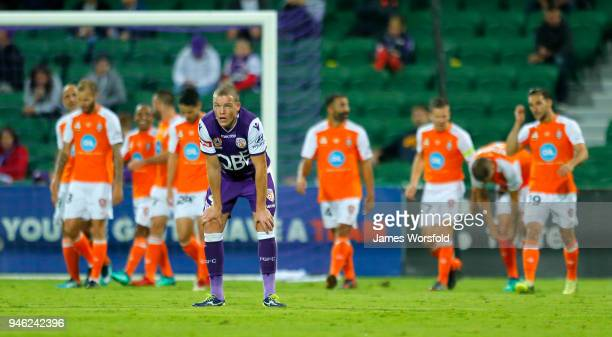 Shane Lowry of the Perth Glory looks to the big screen as watches Brisbane gets their 3rd goal during the round 27 ALeague match between the Perth...