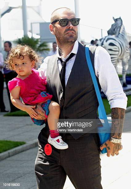 Shane Lynch from Boyzone and child attend the Investec Ladies Day at Epsom Downs on June 4, 2010 in Epsom, England.