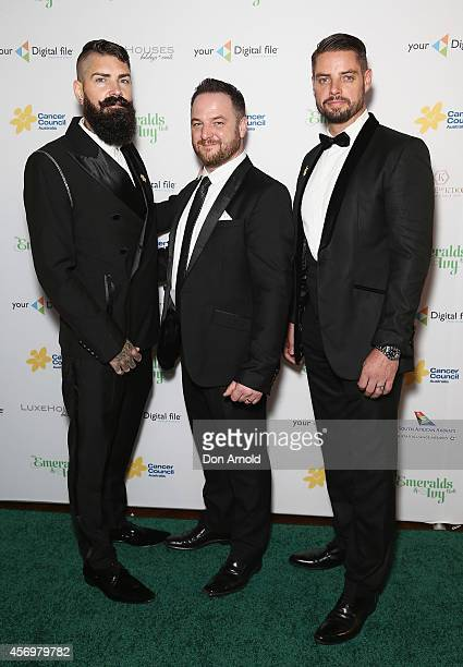 Shane Lynch Mikey Graham and Keith Duffy of Boyzone arrive at The Emeralds and Ivy Ball at Sydney Town Hall on October 10 2014 in Sydney Australia