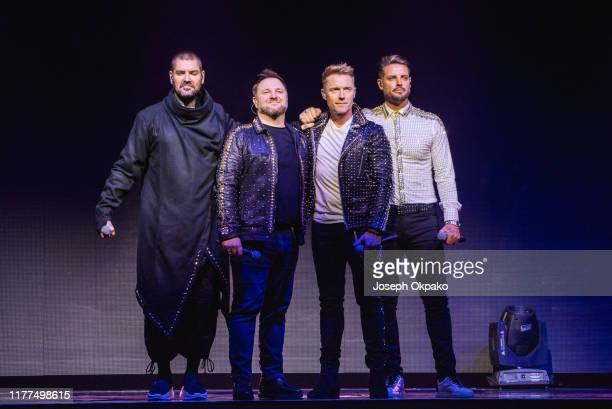 Shane Lynch Mikey Graham Ronan Keating and Keith Duffy of Boyzone perform on stage during The Final Five tour at the London Palladium on October 21...