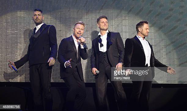 Shane Lynch Ronan Keating Keith Duffy and Mikey Graham of Boyzone perform at BIC on December 4 2013 in Bournemouth England