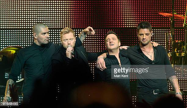 Shane Lynch Ronan Keating Mikey Graham and Keith Duffy of Boyzone perform at the Royal Albert Hall on March 11 2010 in London England