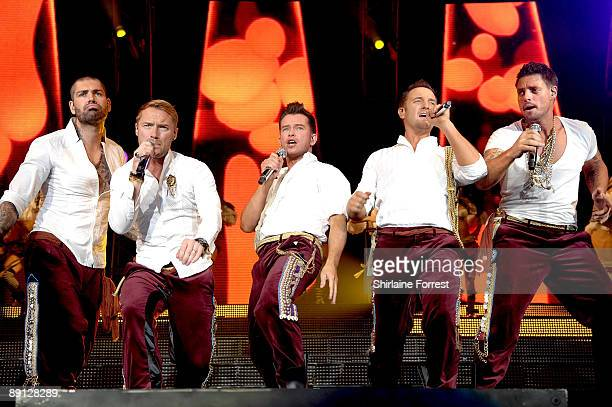 Shane Lynch Ronan Keating Stephen Gately Mikey Graham and Keith Duffy of Boyzone perform at MEN Arena on June 19 2009 in Manchester England