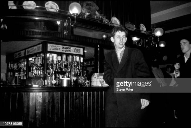 Shane MacGowan and Spider Stacy , of The Pogues at the Crown pub on Cricklewood Broadway, London, 1984.