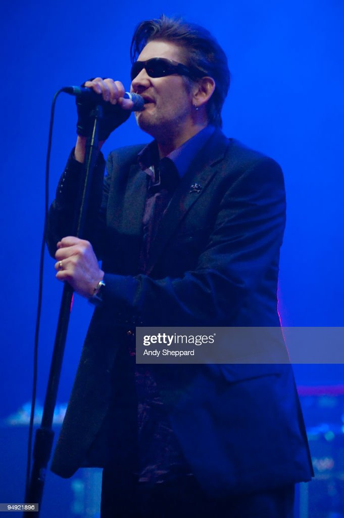 Shane MacGowan of The Pogues performs on stage at Brixton Academy on December 19, 2009 in London, England.