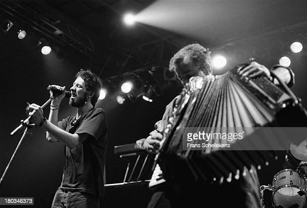 Shane MacGowan performs with the Pogues at the Jaap Edenhal in Amsterdam, Netherlands on 4th November 1989.