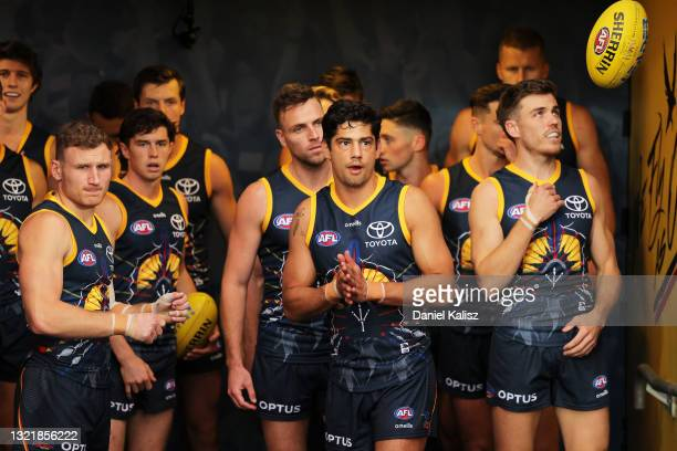 Shane McAdam of the Crows leads his team mates onto the ground during the round 12 AFL match between the Adelaide Crows and the Collingwood Magpies...