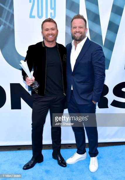 Shane McAnally with husband Michael Baum attend the 13th Annual ACM Honors at Ryman Auditorium on August 21 2019 in Nashville Tennessee