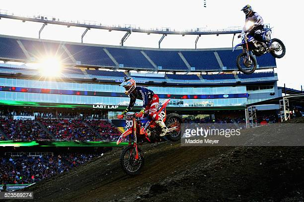 Shane Mcelrath driver of the KTM 250SXF Factory Edition left and Aaron Plessinger driver of the Yamaha YZ250 F race in the 250SX Main Race during...