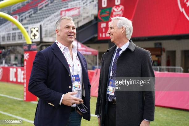 Shane McMahon and XFL Commissioner Oliver Luck talk before the XFL game between the Seattle Dragons and the DC Defenders at Audi Field on February 8...