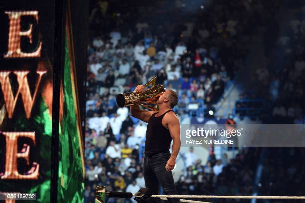 Shane McMahon SmackDown commissioner and minority owner of WWE raises the WWE World Cup trophy following the match as part of as part of the World...