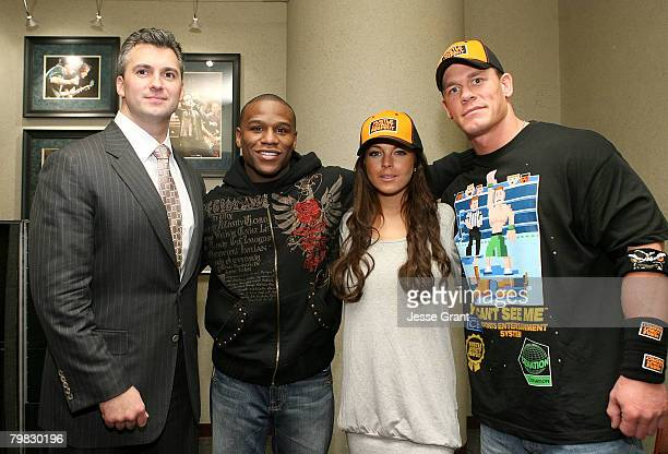 Shane McMahon WBC welterweight champion Floyd Mayweather Jr actress Lindsay Lohan and WWE Superstar John Cena at WWE Monday Night Raw at The Honda...