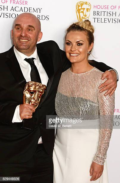 Shane Meadows and Chanel Cresswell winners of Best Mini Series for 'This Is England '90' pose in the winners room at the House Of Fraser British...