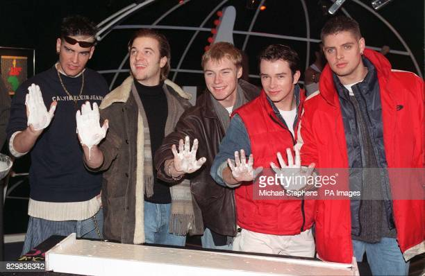 Shane Mikey Ronan Stephen and Keith from the Irish band Boyzone cast their hands in plaster at London's Rock Circus this morning When dry the plaster...