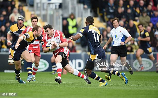 Shane Monahan of Gloucester is tackled by Chris Pennell of Worcester Warriors during the Aviva Premiership match between Worcester Warriors and...