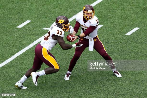 Shane Morris of the Central Michigan Chippewas hands the ball off to Kumehnnu Gwilly during the first quarter against the Boston College Eagles at...