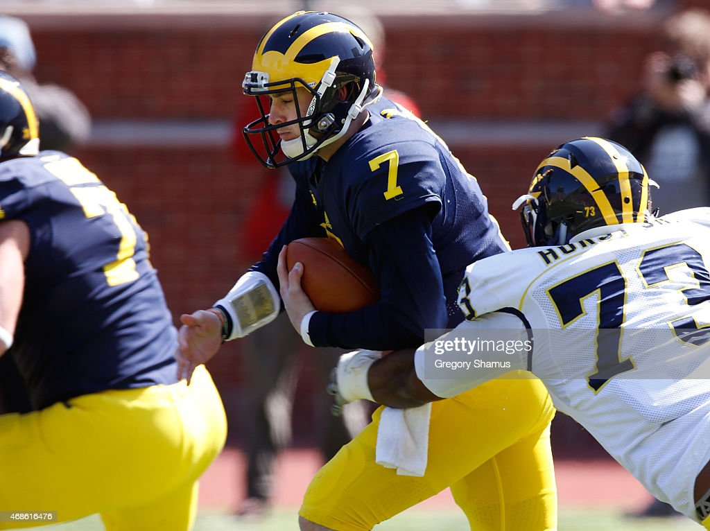 Shane Morris #7 of the Michigan Wolverines tries to outrun Maurice Hurst #73 during the Michigan Football Spring Game on April 4, 2015 at Michigan Stadium in Ann Arbor, Michigan.