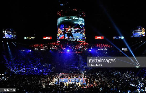 Shane Mosley and Manny Pacquiao of the Philippines in the ring during the second round in the WBO welterweight title fight at MGM Grand Garden Arena...