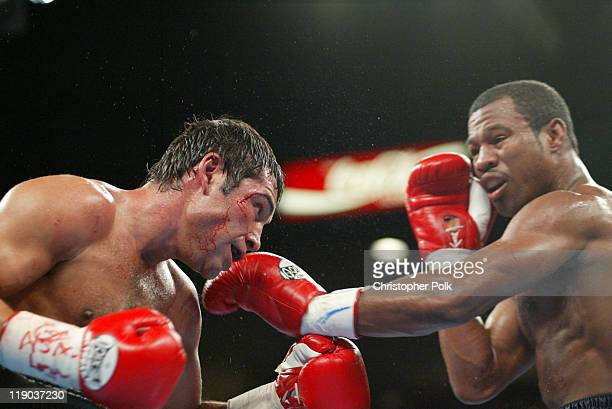Shane Mosley, blue trunks, fights Oscar De La Hoya, black trunks, during a 12-round WBC/WBA Super Welterweight Championship bout held a the MGM Grand...